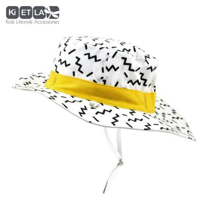KiETLA obojstranný klobúčik s UV ochranou zig-zag